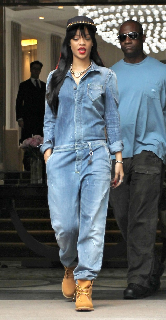 Rihanna is spotted leaving her London Hotel wearing an all-in-one denim jumpsuit, Timberland boots and spiked baseball cap