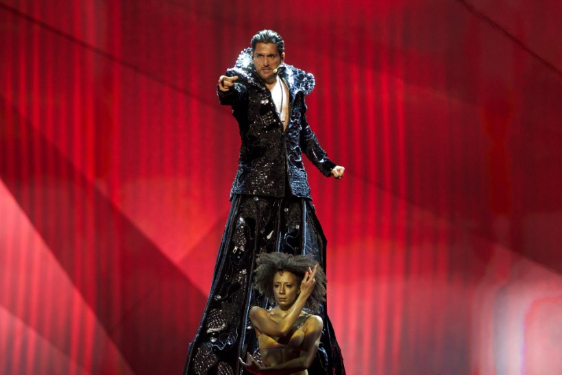 Counter-tenor singer in tall gown