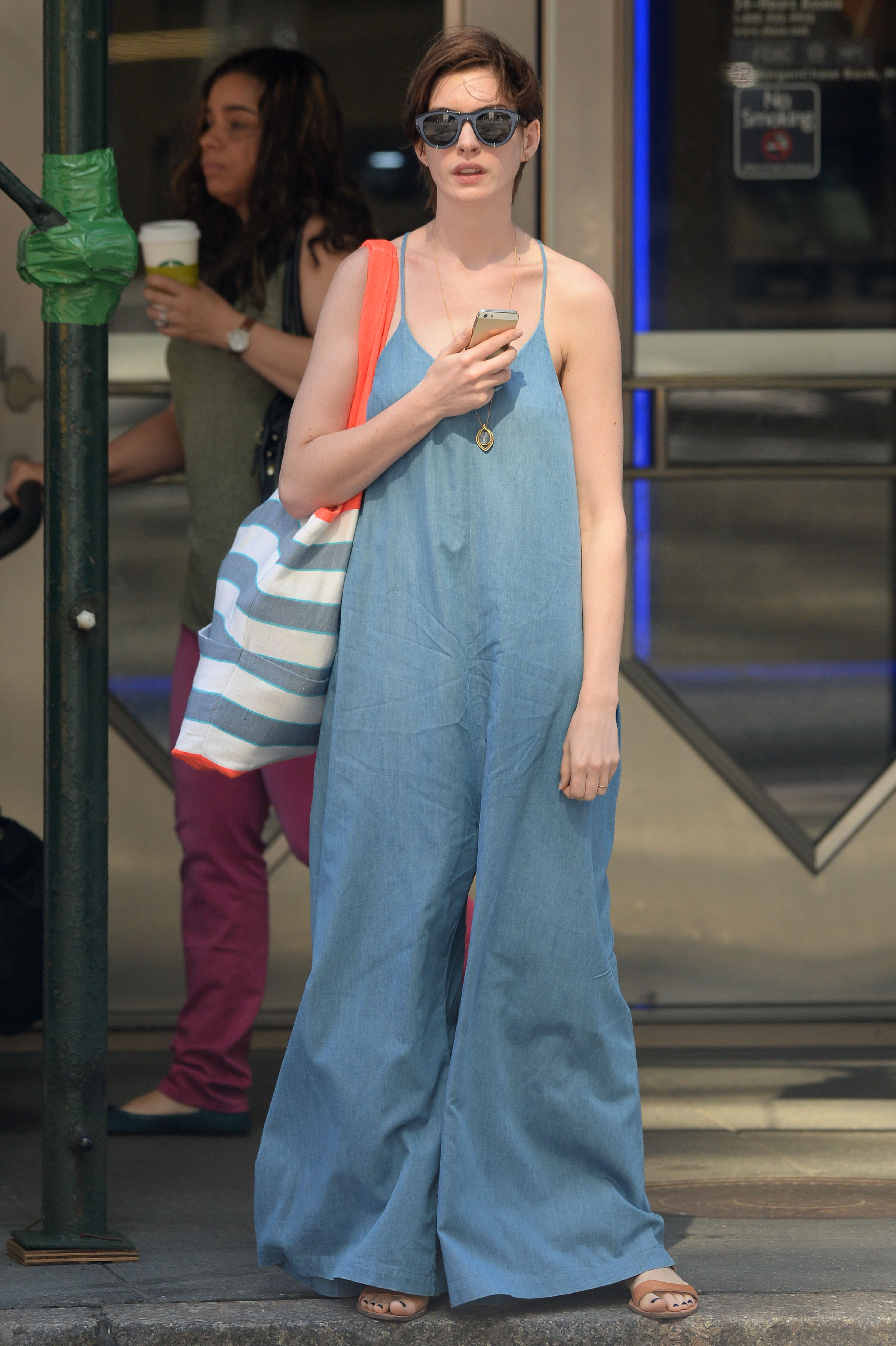 Anne Hathaway exits a taxi cab with a guitar and shopped at Duane Reade on 42nd Street in Manhattan