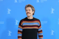 Do You Need To See Willem Dafoe Being Expressive With a Huge Mustache and a Lively Sweater?